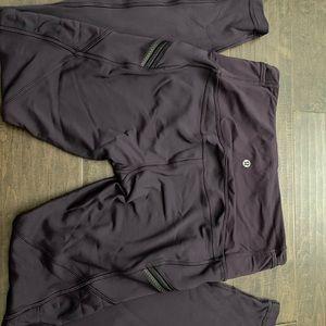 Size 8 lululemon plum tights with light fleece.